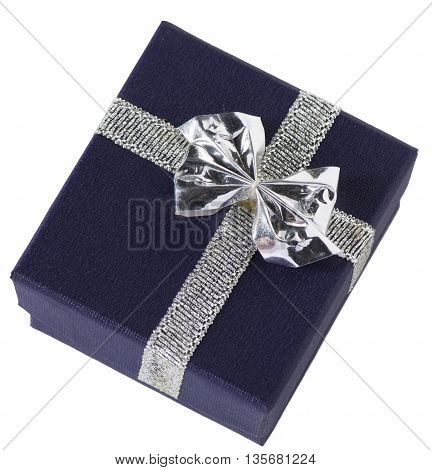 A tiny navy blue gift box with silver bow possibly for jewelry closed isolated on white.