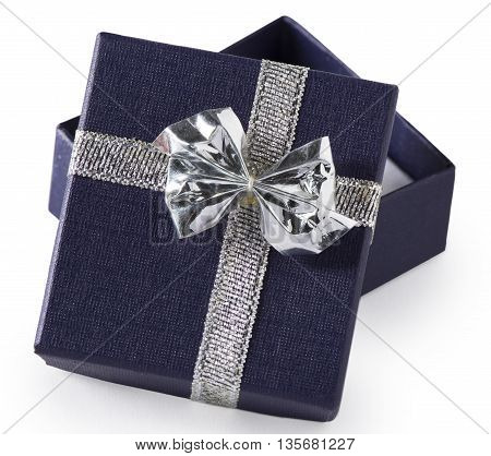 A tiny navy blue gift box with silver bow possibly for jewelry opened isolated on white.