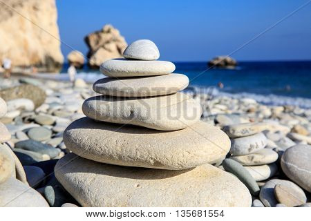 abstract balanced stones on sea in sunny day