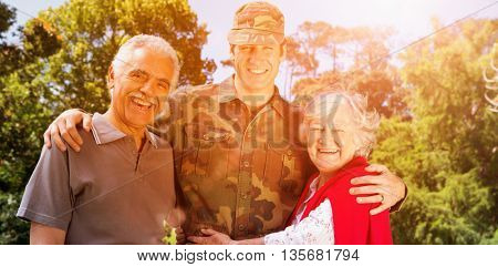 Portrait of army man with parents standing in lawn