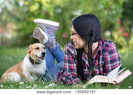 Girl With Dog On Grass