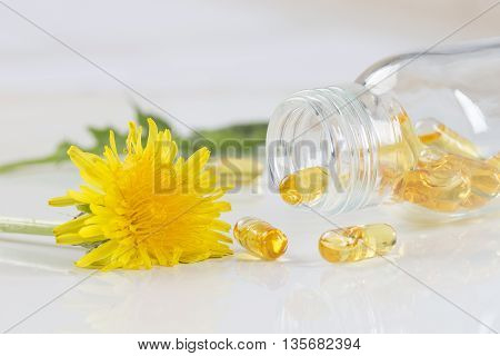Healing herbs and herbal medicine pills with marigold