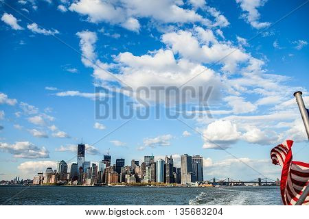 The skyline of Manhattan with boats on the New York Harbor