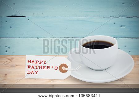 Happy fathers day message in front of coffee