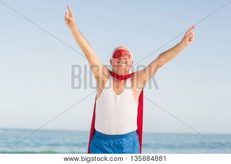 Senior man wearing superman costume on a sunny day
