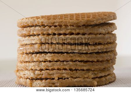 Stack of soft toasted dutch waffles called stroopwafels filled with caramel