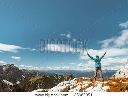 sport women on the top of mountain