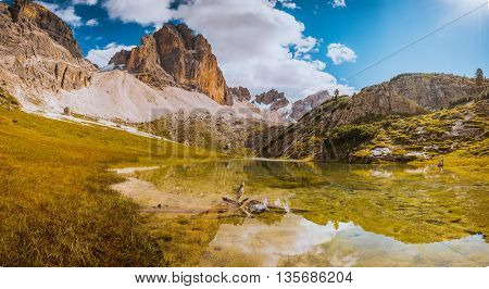 Dolomites lake Mitteralplsee and mountains South Tyrol Italy
