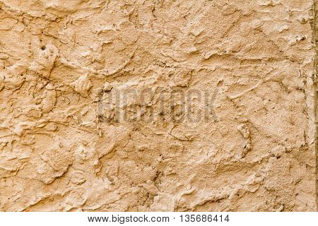 Cream stucco plaster texture surface rugous on close-up