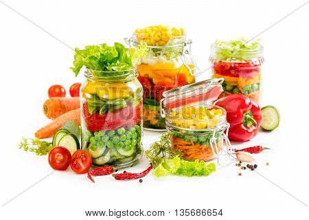 Colorful Vegetables In Glass Jars