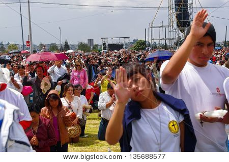 QUITO, ECUADOR - JULY 7, 2015: People raising the hand to receive blessings, pope Francisco mass event.