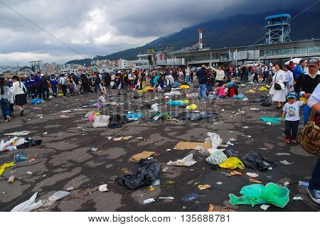 QUITO, ECUADOR - JULY 7, 2015: Pope Francisco event in Quito, after mass people getting out. Garbage on the floor.