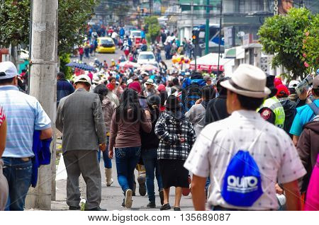 QUITO, ECUADOR - JULY 7, 2015: Crowded large street full of people with cars, pope Francisco mass event.