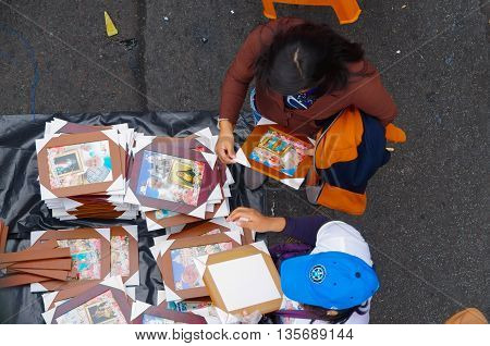 QUITO, ECUADOR - JULY 7, 2015: Above view of little street store selling souvenirs of pope Francisco. Pictures for the mass.