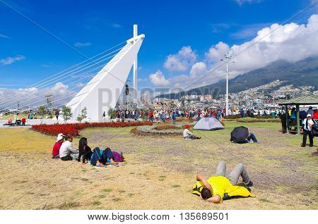 QUITO, ECUADOR - JULY 7, 2015: People lying in the floor on the grass, tents on the floor also, pope Francisco mass.