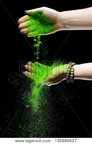 Colorful holi painted hands scattering paint powder
