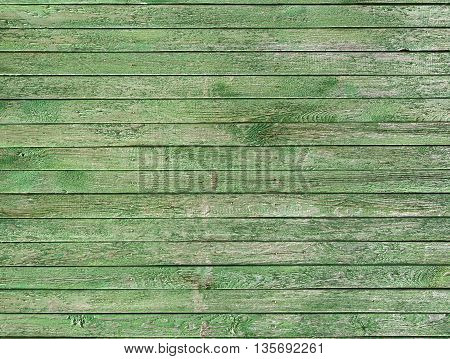 Vintage wood wall with peeling paint as background