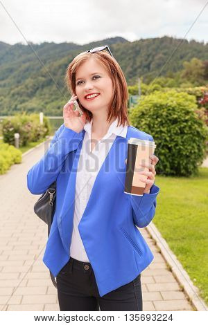 Shot of a young businesswoman talking on her phone while out in the Park