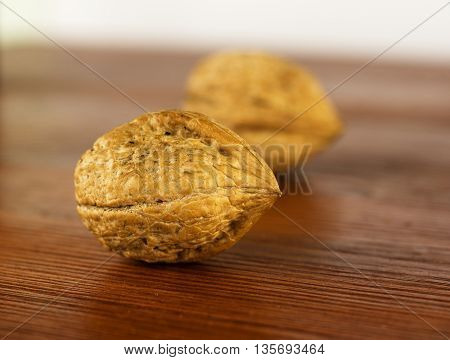 Walnuts on a wooden table. Walnuts in shell.