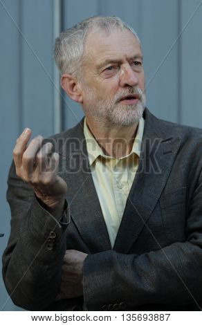 LONDON, UK - SEPTEMBER 10, 2015: Jeremy Corbyn, MP for Islington North and candidate in the Labour Party leadership election, speaks to supporters at the Rock Tower, picture taken from the street