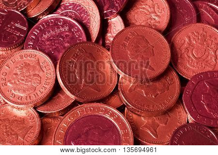 Lots of red vibrant British Pound coins