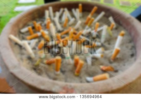 Abstract blurred of cigarette bin at the park