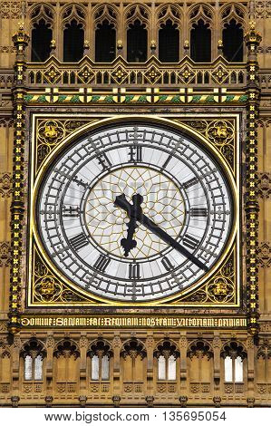 The clock face on the iconic Elizabeth Tower which is home to the historic bell named Big Ben.