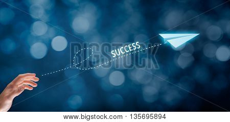 Accelerate success concept. Businessman throw a paper plane symbolizing growing (accelerating) success. Wide banner composition with bokeh in background.