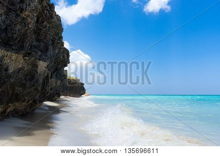 Cuban coastline with beach under blue sky in Cuba Varadero
