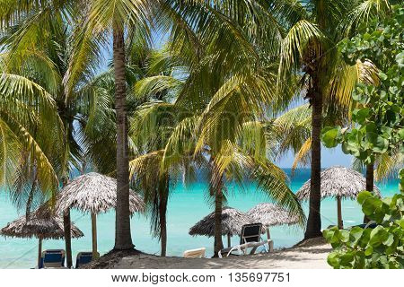 Cuban dream beach in Varadero with sun lounger and thatched hut in Cayo Santa Maria