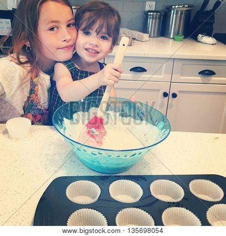 Two Sisters baking in kitchen - with Instagram effect