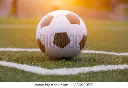 Soccer ball on the field with morninglight