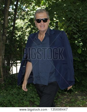 LONDON, UK, JUN 15, 2015: Mario Testino attends the Burberry Prorsum fashion show for LFW picture taken from the street