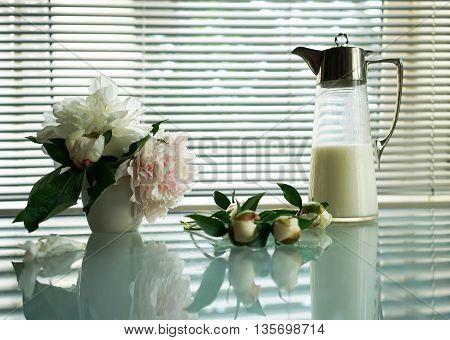 still life splendid bouquet peony and Antique jug with milk
