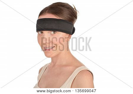 Sport's beauty - close-up of a woman look at the camera after workout wearing medical sport hair band isolated on white background