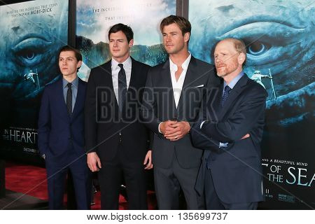 NEW YORK-DEC 7:(L-R) Tom Holland, Benjamin Walker, Chris Hemsworth and director Ron Howard attend the