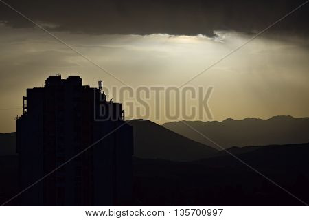 Silhouette of a building and cloudy sky over the city