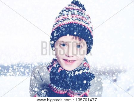 Winter Child Boy smiling on Snow Background