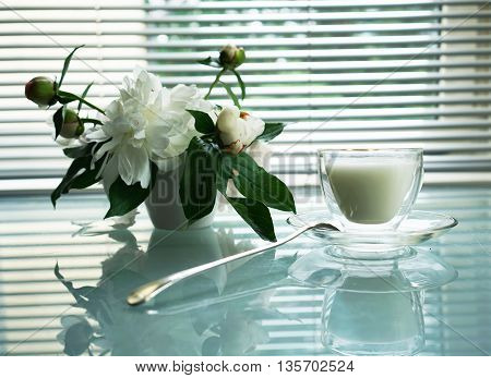 still life splendid bouquet peony and cup with milk