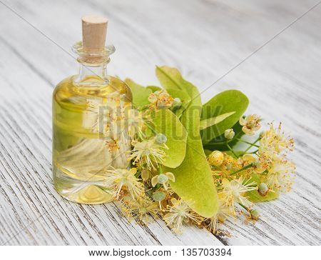 bottle of essential linden oil on the table