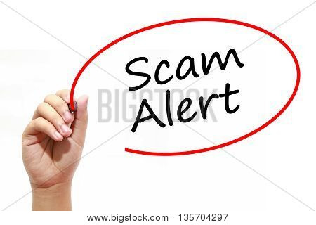 Man Hand writing Scam Alert with marker on transparent wipe board. Business internet technology concept.