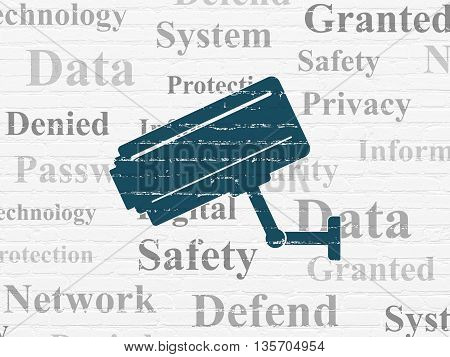 Protection concept: Painted blue Cctv Camera icon on White Brick wall background with  Tag Cloud