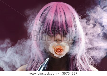 Portrait of girl with pink long hair smoking