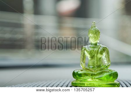 image of green buddha on the car console