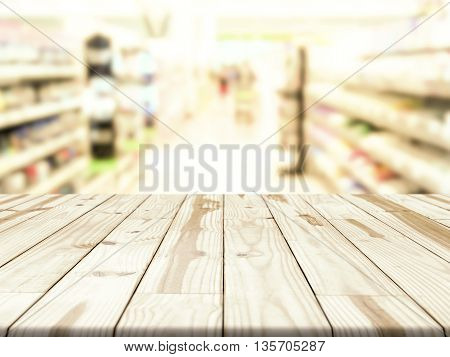 Wood table and blurry Shopping store in background. Empty table for display.
