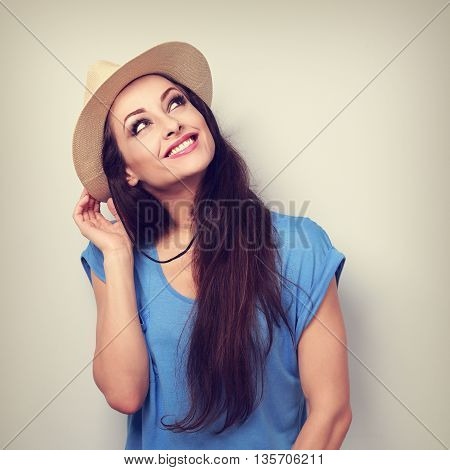 Happy Casual Woman In Summer Hat Thinking About Vacation And Looking Up. Toned Vintage Portrait