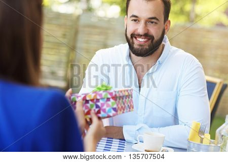 Picture of young couple celebrating birthday in restaurant