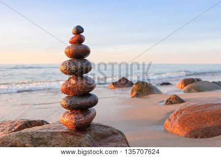 Concept of balance and harmony. Rock Zen at sunset