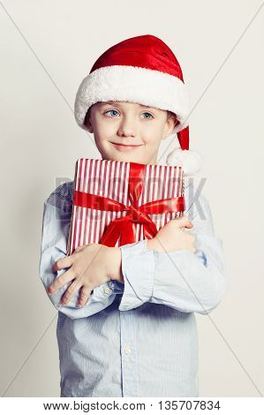 Christmas Child Boy in Santa Hat and Gift Box