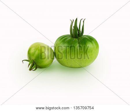 Studio shot of green tomato. Fresh organic vegetables.